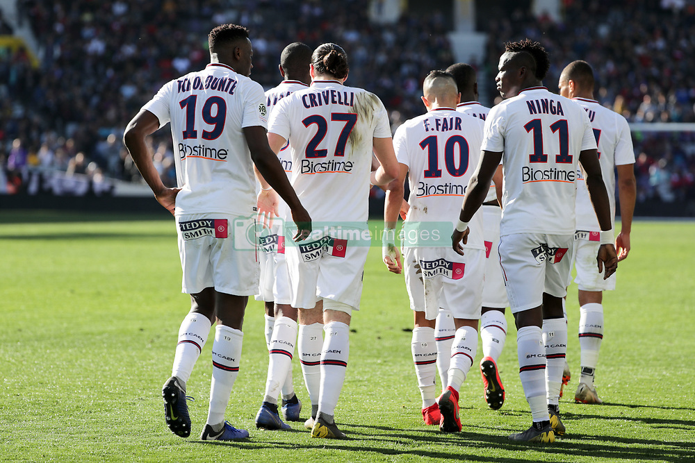 February 24, 2019 - Toulouse, France - 19 MALIK TCHOKOUNTE (CAEN) - 27 ENZO CRIVELLI (CAEN) - 11 CASIMIR NINGA (CAEN) - DOS - JOIE (Credit Image: © Panoramic via ZUMA Press)