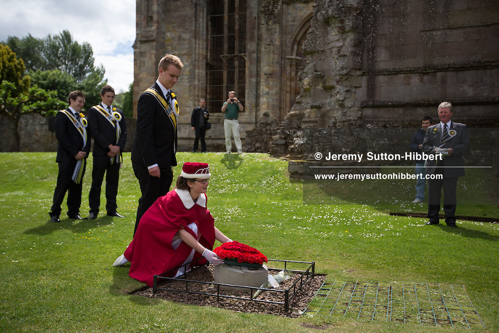A stop during The Tour Of Ceremonies at Melrose Abbey, with local people dressed as monks and Kind David, and with Melrosian Sam Thomson and Festival Queen Zoe Palmer, and their courts, laying a wreath over the spot which some believes marks the location of the heart of Robert The Bruce, during the Melrose Festival, near Melrose, Scotland, Saturday 22nd June 2013.<br /> N55&deg;35.965'<br /> W2&deg;43.065'