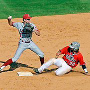 Arkansas second baseman Brian Anderson (1) attempts to turn a double play as Mississippi's Will Allen (30) slides into second during an NCAA college baseball game in Oxford, Miss., Saturday, May 3, 2014. (Photo/Thomas Graning)