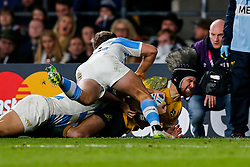 Australia Inside Centre Matt Giteau South Africa is tackled by Argentina Winger Santiago Cordero shortly before going off with a possible injury - Mandatory byline: Rogan Thomson/JMP - 07966 386802 - 25/10/2015 - RUGBY UNION - Twickenham Stadium - London, England - Argentina v Australia - Rugby World Cup 2015 Semi Finals.