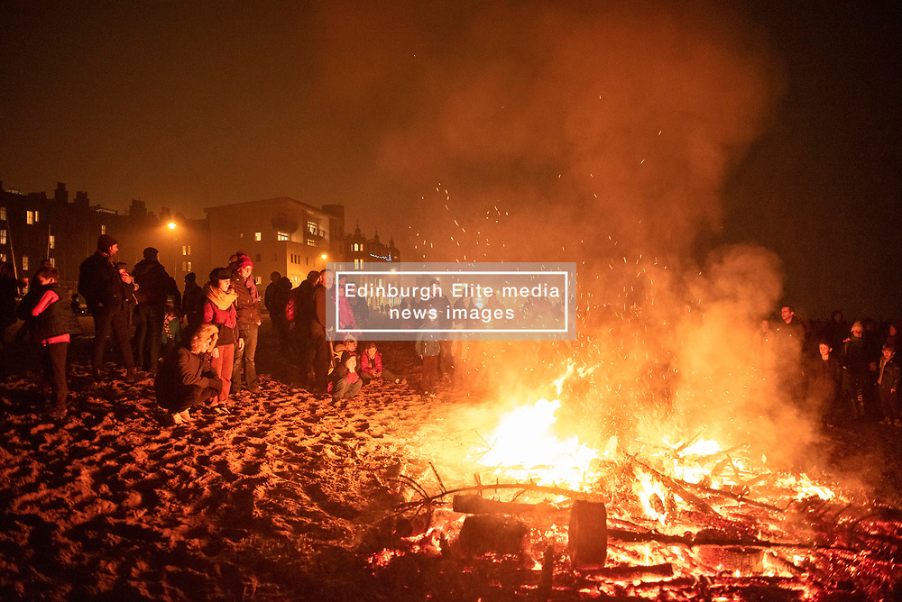 People gathered on Portobello Beach Edinburgh for the annual burning of the Christmas Trees to mark the end of the festive season. A big crowd gathered despite the drizzle to enjoy the spectacle.<br /> © Jon Davey/ EEm