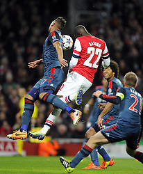 Arsenal's Yaya Sanogo heads against Bayern Munich's Jerome Boateng - Photo mandatory by-line: Joe Meredith/JMP - Tel: Mobile: 07966 386802 19/02/2014 - SPORT - FOOTBALL - London - Emirates Stadium - Arsenal v Bayern Munich - Champions League - Last 16 - First Leg