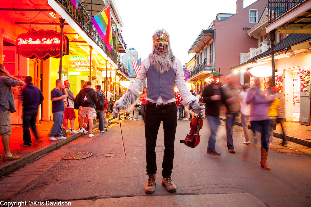 Traveling street performer know as the Violin Monster plays a tune on his violin on Bourbon Street in New Orleans.