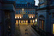 Couple holding hands and taking a nighttime stroll in Royal Exchange Square in the City Centre, Glasgow. Scotland