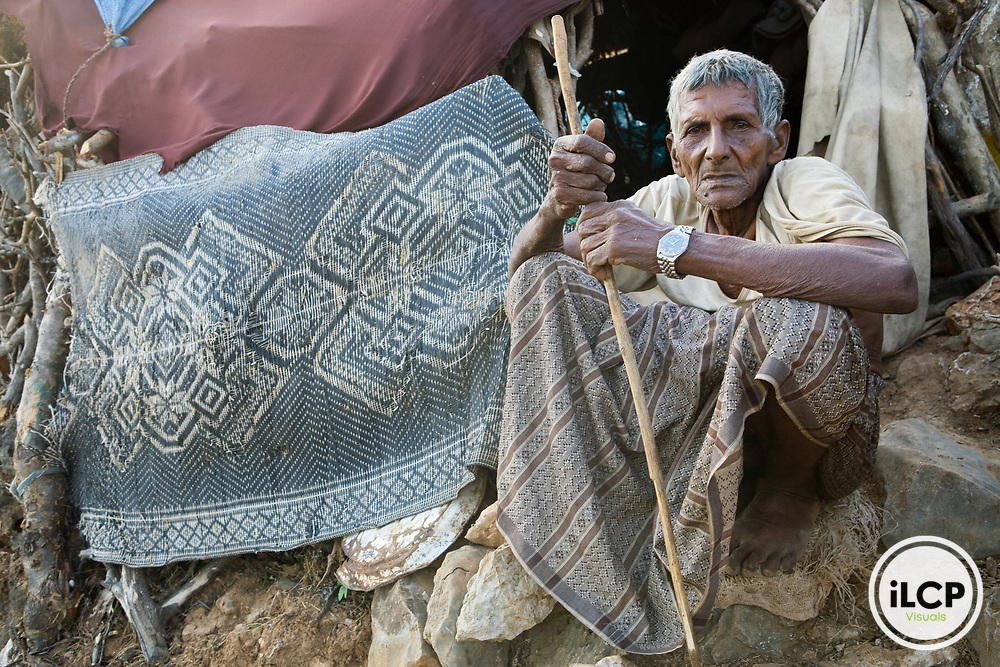 Herder sitting in front of his hut, Hawf Protected Area, Yemen