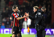 AFC Bournemouth midfielder Dan Gosling is substituted and congratulated by AFC Bournemouth manager Eddie Howe during the Barclays Premier League match between Bournemouth and Norwich City at the Goldsands Stadium, Bournemouth, England on 16 January 2016. Photo by Graham Hunt.