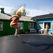 Toustrup Mark Community,  Sporup, Denmark, June, 5, 2010. Lea jumps in the garden. Toustrup Mark, 30 km west of Aarhus, has 25 apartments and a total of 70 inhabitants.<br />