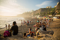Lima, Peru- March 22, 2015: Set beneath the coastal bluffs, the pebbly beaches of Lima attract a healthy mix of surfers and locals just looking to beat the heat.  CREDIT: Chris Carmichael for The New York Times