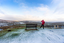 © Licensed to London News Pictures. 29/11/2017. Hawes UK. A man stands at the top of Butter tubs pass in Yorkshire & looks out across a frost covered landscape towards Cumbria this morning. Photo credit: Andrew McCaren/LNP