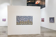 DUBAI, UAE - APRIL 30, 2016: 'Magnetic Bodies: Imaging the Urban', is an art exhibition of Egyptian artist Huda Lutfi. The Third Line is an art gallery that showcases  contemporary Middle Eastern artists.