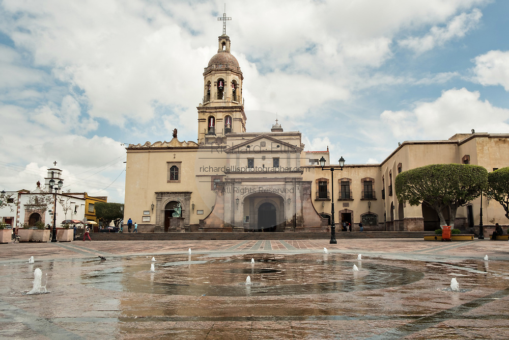 Fountain and Holy Cross Church and Franciscan Convent also called the Templo y Convento de la Santa Cruz on Founders Plaza in the old colonial section of Santiago de Queretaro, Queretaro State, Mexico.