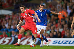 CARDIFF, WALES - Friday, September 5, 2008: Wales' Gareth Bale and Azerbaijan's Rail Melikov during the opening 2010 FIFA World Cup South Africa Qualifying Group 4 match at the Millennium Stadium. (Photo by David Rawcliffe/Propaganda)