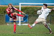 Essex's Tristan Salgado (16) tries to block the kick by CVU's Kyler White-Hansen (11) during the boys soccer game between the Champlain Valley Union Redhawks and the Essex Hornets at Essex High School on Saturday mooring October 10, 2015 in Essex. (BRIAN JENKINS/For the FREE PRESS)