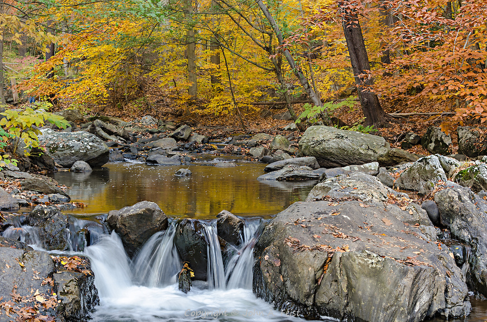 What a tranquil spot to enjoy the fall colors and the quiet rushing of the water over the mini waterfall.  The wonderful autumn colors help to bring a feeling of quiet and peace on a glorious fall day.