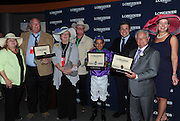 Jennifer Judkins, right, and Juan-Carlos Capelli, third right, both of Longines, award trainer Art Sherman, second right, jockey Victor Espinoza and owners Steve and Carolyn Coburn, second left, and Perry and Denise Martin, left, with their Longines Conquest Classic chronographs after California Chrome won the 140th Kentucky Derby, Saturday, May 3, 2014, in Louisville, Ky. Longines, the Swiss watchmaker known for its famous timepieces, is the Official Watch and Timekeeper of the 140th annual Kentucky Derby. (Photo by Diane Bondareff/Invision for Longines/AP Images)