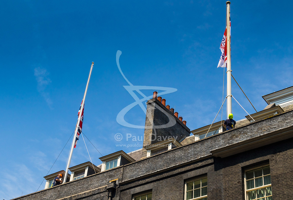 London, June 19th 2017. Workers lower the flags at Downing Street to half mast in the wake of the Finsbury Park attack which left one dead and ten injured after a van was driven into Muslim worshipers. London, June 19th 2017. Workers lower the flags at Downing Street to half mast in the wake of the Finsbury Park attack which left one dead and ten injured after a van was driven into Muslim worshipers. The right hand flag commemorates Armed Forces Day.