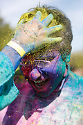 More than 1,500 participants throw colored powder on each other to celebrate the end of Winter and beginning of Spring during Holi, a Hindu Festival of Colors, at Cardoza Park in Milpitas, California, on March 23, 2013. (Stan Olszewski/SOSKIphoto)