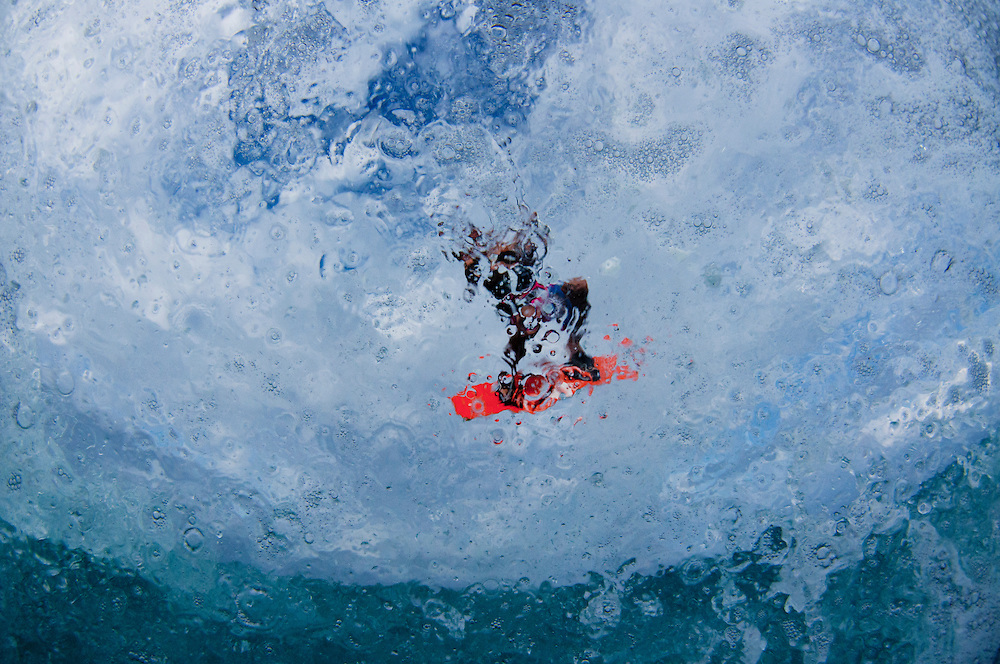Abstract image of a kite boarder flying through the air.