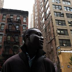 "NEW YORK, NY. OCTOBER 15, 2010. Tokunbo Ajiboye, aka ""TK"", in a street near Time Square in Manhattan, a few blocks aways from the business school he's attending. (Photo: Antoine Doyen)"