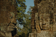 The smiling faces of Avalokiteshvara at the Bayon temple in Angkor Thom city.<br /> <br /> The Bayon is the second most well known temple after Angkor Wat in the Angkor complex located at the center of Angkor Thom city.  The ruins of Angkor, a UNESCO World Heritage Site with temples numbering over one thousand, are hidden amongst forests and farmland to the north of the Tonle Sap Lake (Great Lake) and south of the Kulen Hills outside the modern city of Siem Reap, Cambodia.  Angkor served as the seat of the Khmer empire and flourished from approximately the 9th century to the 13th century. <br /> <br /> Built in the late 12th or early 13th century as the official state temple of King Jayavarman VII,  the Bayon temple is comprised of <br /> 54 towers with the smiling face of Avalokiteshvara.<br /> <br /> These Buddhist Saints or bodhisattva embody the compassion of all Buddhas and are a beautiful and powerful sight to behold. Exploring the Bayon was an amazing experience.