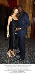 Fashion designer OZWALD BOATENG and his wife GYUNEL at a ball in London on 18th April 2004.PTG 131