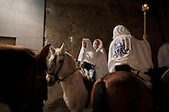 "Young horse riders march during the ""La Encamisa"" Festival on December 7,  2014 in Torrejoncillo, Extremadura region, Spain. ""La Encamisa"" is an ancient festival in honor of Immaculate Conception. Hundreds of horsemen wearing a white sheet gather outside the church in the main square. The procession starts when a banner with the image of Immaculate Conception is delivered to the horse rider steward and people cheer and shoot blanks. There are bonfires along the way where people gather to chat, eat traditional sweets and drink local wine. The origin of this tradition is unknown but it is believed the festival comes from a military event in which people from Torrejoncillo were involved. The war in Flanders in 1585, the Battle of Pavia or a legend of the siege suffered by city of Coria. (© Pablo Blazquez)"