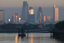 © Licensed to London News Pictures. 06/10/2013.  The morning sun reflecting off City of London skyscrapers as viewed from Greenwich. Greenwich got off to a gloriously sunny day this morning with temperatures to hit 22 degrees today. Credit : Rob Powell/LNP