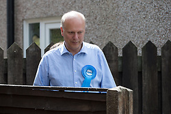 © Licensed to London News Pictures . 03/06/2014 . Newark , Nottinghamshire , UK . Secretary of State for Justice , CHRIS GRAYLING , campaigning for Conservative Party candidate Robert Jenrick , who was absent , in Newark today (Tuesday 3rd June 2014) ahead of the by-election due to take place on Thursday (5th June 2014) . Photo credit : Joel Goodman/LNP