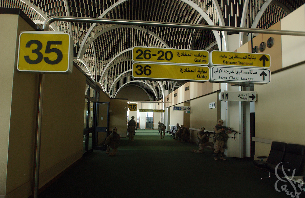 U.S. Army 3rd Division 3-7 soldiers secure the main terminal of Baghdad International Airport April 4, 2003 during an allied advance on the Iraqi capital. U.S. and Iraqi forces exchanged heavy fire throughout the day as they battled for control of the strategic facility.