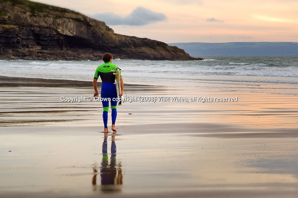 Surfer at sunset / early evening<br /> Dunraven Bay<br /> Southerndown<br /> Glamorgan Heritrage Coast<br /> South<br /> Surfing<br /> Activities &amp; Sports