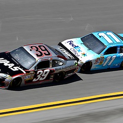 April 17, 2011; Talladega, AL, USA; NASCAR Sprint Cup Series driver Denny Hamlin (11) drafts Ryan Newman (39) during the Aarons 499 at Talladega Superspeedway.   Mandatory Credit: Derick E. Hingle