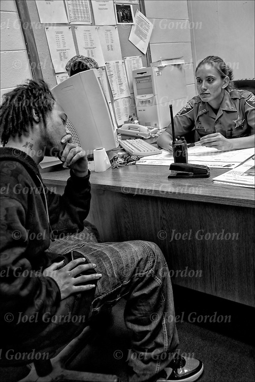 White Female Deputy Sheriff  SRO the School Resource Officer with student in her office for disciple problem.  <br /> <br /> Resource Officer provides security to the school grounds, helps administrators to ensure the safety of students. Deals with problems that are violations of FL statues that school administrators can not handle.