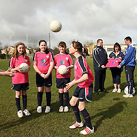 Aoife McNamara, Orla Maloney, Elaine Wall, Laura Browne and Jane Taylor with Frank Gormley, Marie Barrett and Denis Hynes at the launch of the FAI AVIVA Easter Soccer Sisters during the week.<br /> Photograph by Yvonne Vaughan