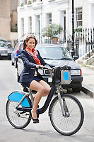 Portrait of young businesswoman commuting by her bicycle