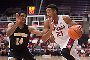 November 14, 2014; Stanford, CA, USA; Stanford Cardinal guard/forward Anthony Brown (21) dribbles the basketball against Wofford Terriers guard Spencer Collins (14) during the first half at Maples Pavilion.