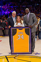 02 April 2013: Shaquille O'Neal, right, poses with Jeanie Buss and Phil Jackson with his framed jersey during the jersey retirement ceremony for retired Los Angeles Lakers center (34) Shaquille O'Neal during halftime of  the Lakers 101-81 victory over the Dallas Mavericks at the STAPLES Center in Los Angeles, CA.