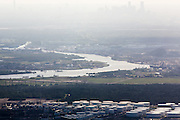 Haze over the Houston Ship Channel, with downtown Houston visible in the distance.