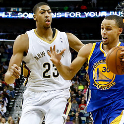 Nov 26, 2013; New Orleans, LA, USA; Golden State Warriors point guard Stephen Curry (30) drives past New Orleans Pelicans power forward Anthony Davis (23) during the second half of a game at New Orleans Arena. The Warriors defeated the Pelicans 102-101. Mandatory Credit: Derick E. Hingle-USA TODAY Sports