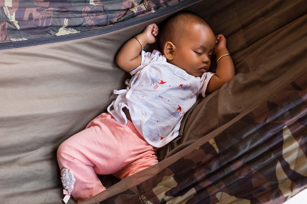 Kampot, Cambodia. Six months old Khmer Child sleeping in a Hammock. Photo by Lorenz Berna