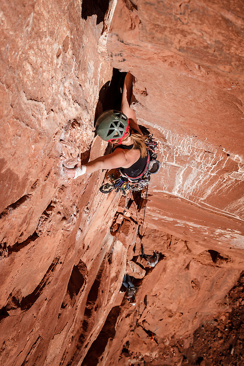 Kim Hall climbs the third crux pitch of Kor Ingalls, 5.10, Castle Valley, Utah.