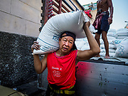 12 FEBRUARY 2018 - BANGKOK, THAILAND: Men unload sugar from a truck at a warehouse in the Chinatown neighborhood of Bangkok.     PHOTO BY JACK KURTZ