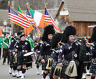 Goshen, New York - Members of a pipe and drum band wear traditional dress while marching in the mid-Hudson St. Patrick's Day parade on March 13, 2011. ©Tom Bushey / The Image Works
