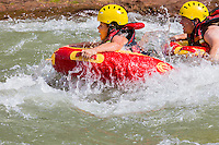 ADULTOS Y UN NINO DE 8 ANOS HACIENDO HYDROSPEED, RIVERBOARDING O COOL RIVER EN EL RIO ATUEL, VALLE GRANDE, SAN RAFAEL, PROVINCIA DE MENDOZA, ARGENTINA (PHOTO BY &copy; MARCO GUOLI - ALL RIGHTS RESERVED)<br /> <br /> Riverboarding is a boardsport in which the participant lies prone on their board with fins on their feet for propulsion and steering. This sport is also known as hydrospeed in Europe and as riverboarding or white-water sledging in New Zealand, depending on the type of board used.[1][2] Riverboarding includes commercial, recreational and the swiftwater rescue practice of using a high-flotation riverboard, designed for buoyancy in highly aerated water (Wikipedia).