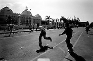 Port au Prince, Haiti.March 7, 2004.Shooting breaks out during an anti-Aristide demonstration. Several people were injured and at least two died. One was a Haitian man shot by athe US Marine -- the first Haitian killed by an US soldier during this intervention.