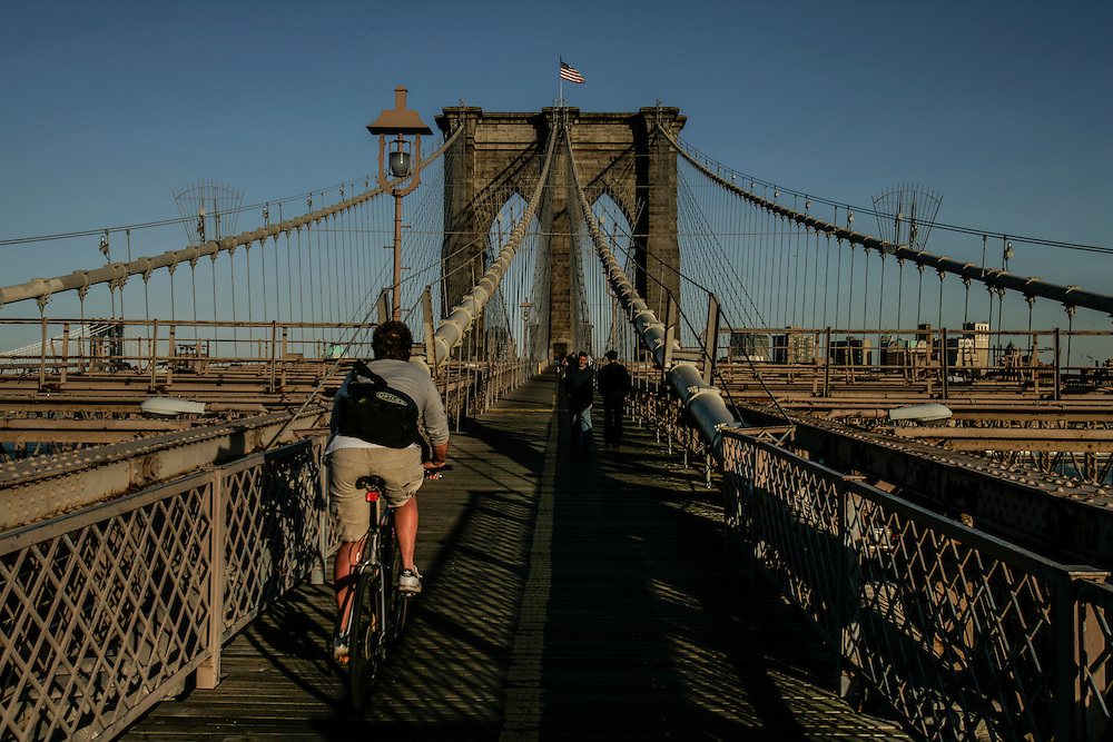 Bikers passing in Brooklyn bridge in New York.