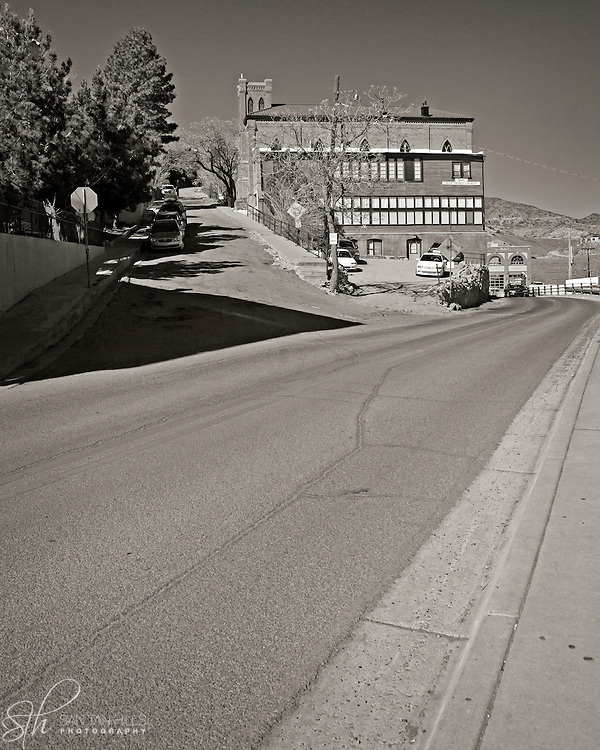 A steep side street winds behind the Holy Family Catholic Church in Jerome, AZ