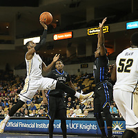ORLANDO, FL - DECEMBER 31:  Daiquan Walker #4 of the UCF Knights drives to the net during an NCAA basketball game against the Tulsa Golden Hurricane at the CFE Arena on December 31, 2014 in Orlando, Florida. (Photo by Alex Menendez/Getty Images) *** Local Caption *** Daiquan Walker