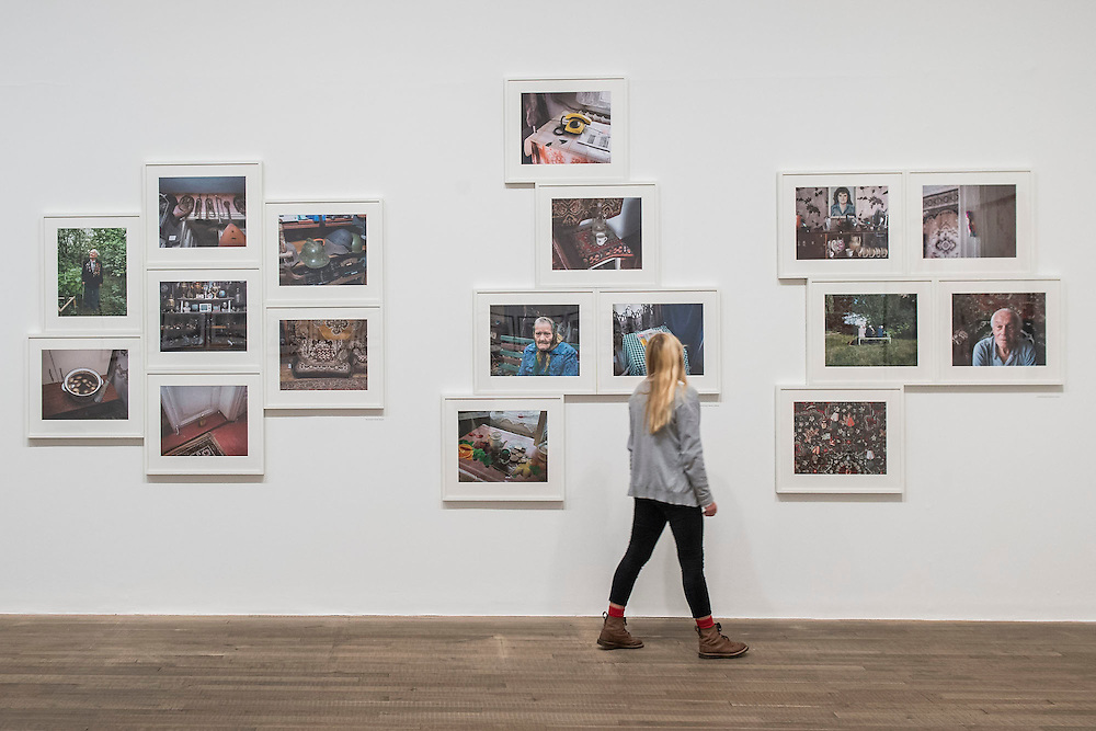 Work on the Ukraine by Stephen Shore, 67 Years after WW2. Conflict, Time, Photography, a new exhibition at the Tate Modern - showcasing the unique ways photographers look back at moments of conflict, from the seconds after a bomb is detonated to 100 years after a war has ended. It includes: renowned photographers Don McCullin, Kikuji Kawada and Taryn Simon; Luc Delahaye's large-scale image of the US bombing of Taliban positions in Afghanistan, showing a cloud of smoke rising from the battlefield; Hiromi Tsuchida's large-scale photograph of a watch stopped at the moment the atomic bomb fell on Hiroshima in 1945; The Archive of Modern Conflict's colourful and chaotic new installation, bringing together war-related images and objects from around the world and across the past 100 years; and Chloe Dewe Mathews's haunting landscapes photographed at dawn, showing the places where British soldiers were executed for desertion and cowardice in the First World War. The show runs from 26 November 2014 – 15 March 2015. Tate Modern, London, UK 25 Nov 2014.