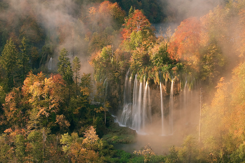 Daybreak light and fog on the Veliki Prstvaci waterfalls close to Gradinsko lake, Upper Lakes, Plitvice National Park, Croatia