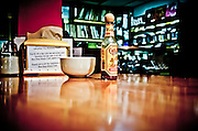 Coffee & a bottle of Chalula Hot Sauce sit on the table in The Bus Stop Music Cafe in Pitman, NJ.